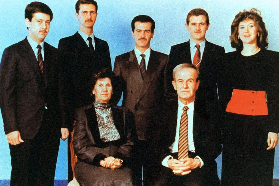 Syrian President Hafez al-Assad (below right) and his wife Anisa Makhlouf (below left) posing for a family picture with his children (L to R) Maher, Bashar, Basil, Majd and Bushra