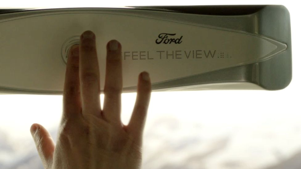 A hand turns on Ford's Feel the View windows