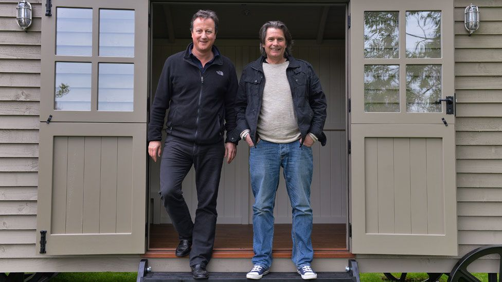 David Cameron in his shepherd's hut with Paul Bennett
