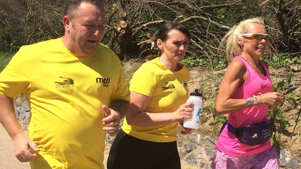 Andrew Bowen and We Can Run Llanelli team-mate Angharad Griffiths with coach Sharon Leech