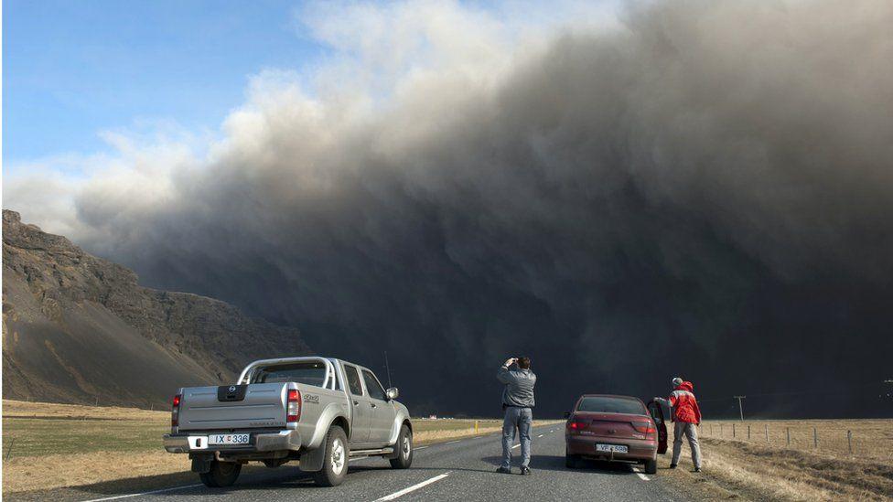 Motorists take pictures of Iceland's Eyjafjallajokull volcano in 2010