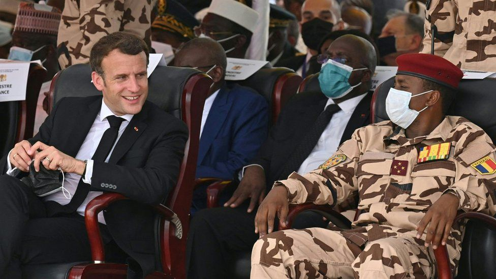 French President Emmanuel Macron (L) and the son of the late Chadian president Idriss Deby, general Mahamat Idriss Deby (R), attend the state funeral for the late Chadian president Idriss Deby in N'Djamena on April 23, 2021.