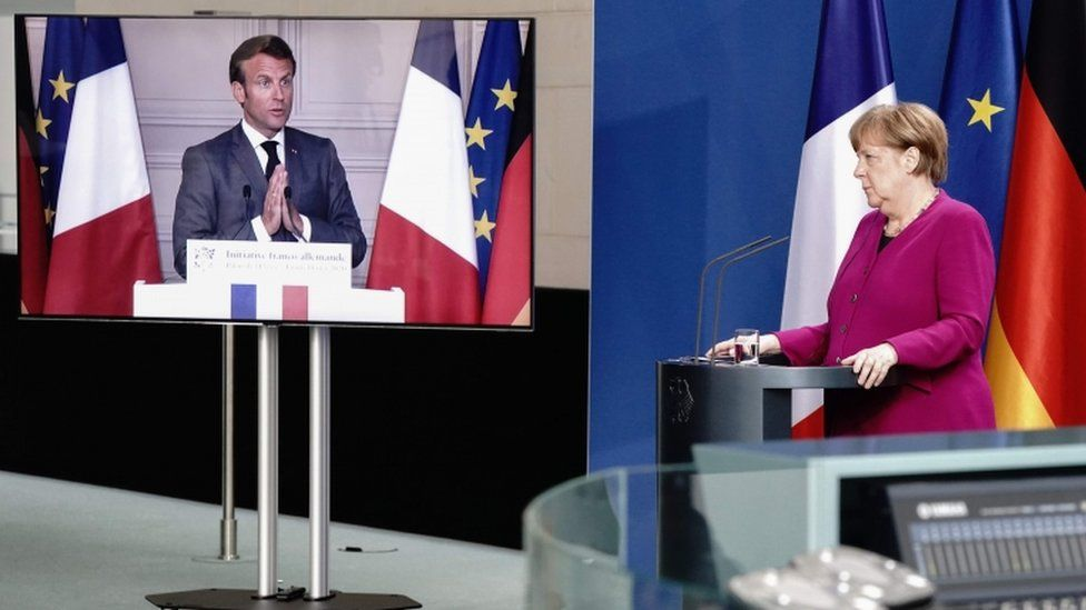 German Chancellor Angela Merkel listens during a joint press conference with French President Emmanuel Macron on 18 May