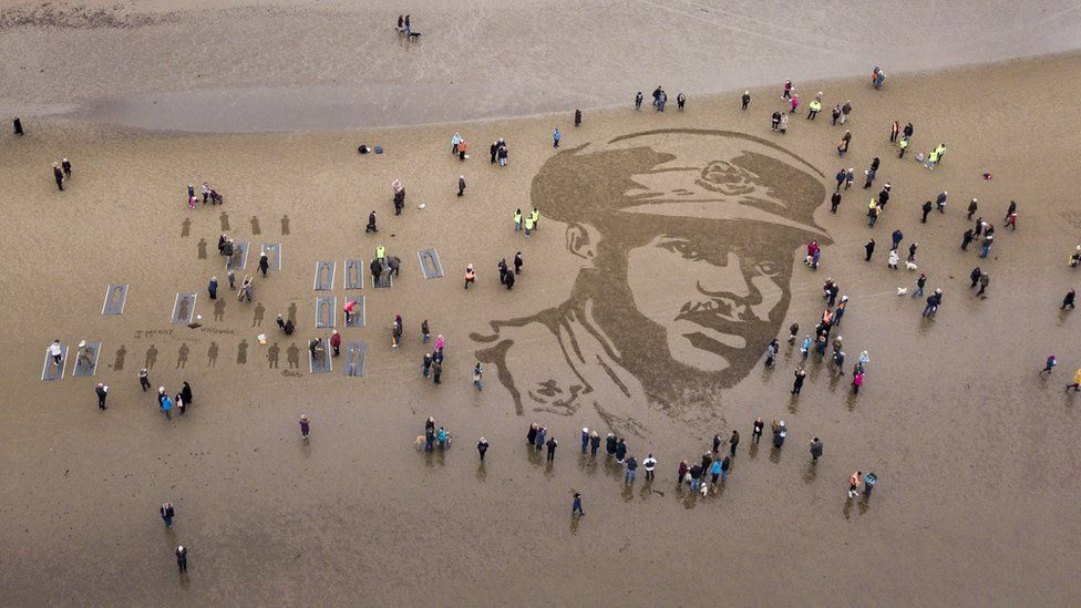 A picture of the British Army's first black officer Walter Tull is seen on Ayr Beach