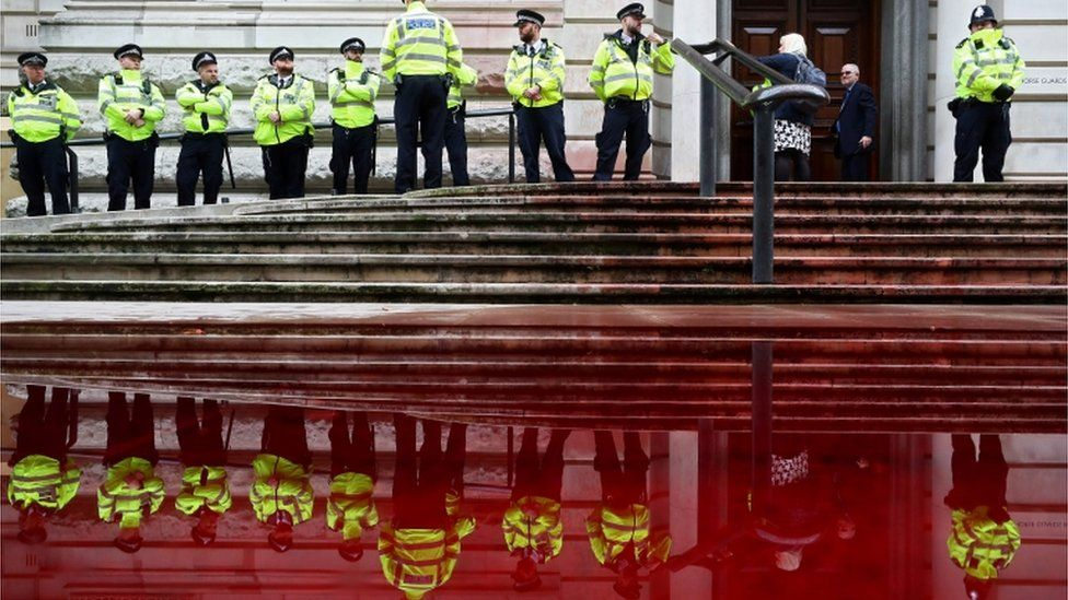 Police stands in front of the Treasury building during an Extinction Rebellion protest in London