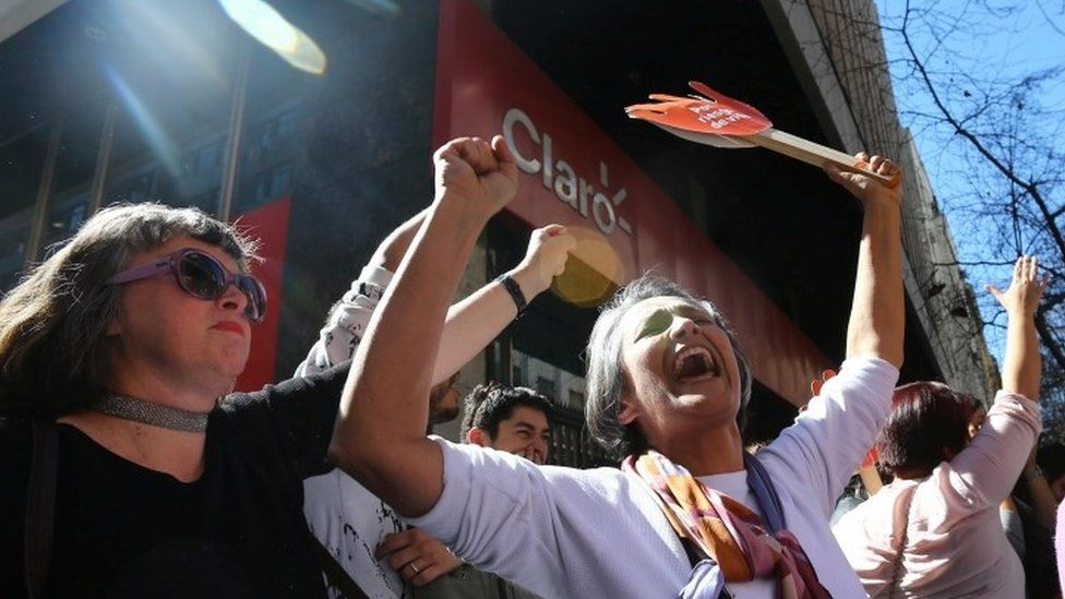 Demonstrators in favour of abortion celebrate after of the members of a constitutional court ruled that a law legalising abortion in certain cases is constitutional at Santiago