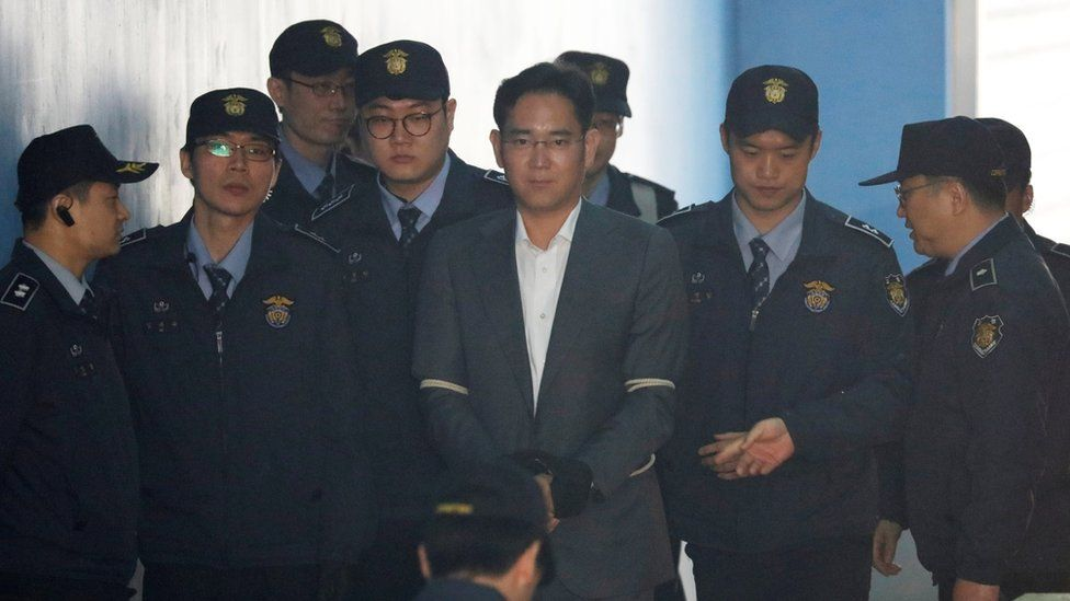 Mr Lee arrives at court in Seoul, South Korea, flanked by police officers and wearing handcuffs. April 7, 2017.