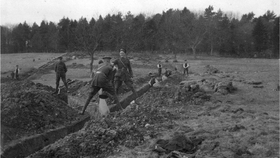 Soldiers digging trenches at Clandeboye, the muddy conditions good practice for the Somme battlefield