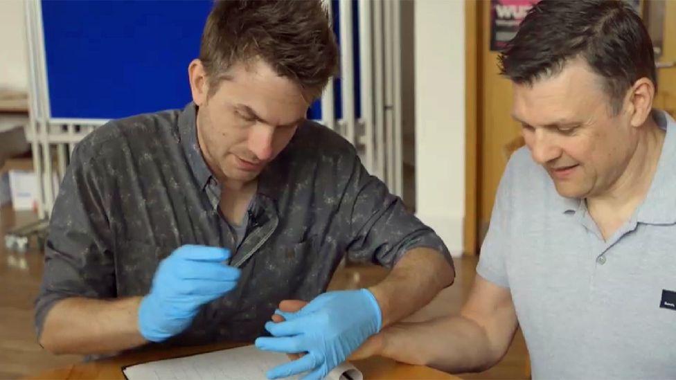 Test volunteer undergoes blood test with Dr Brown