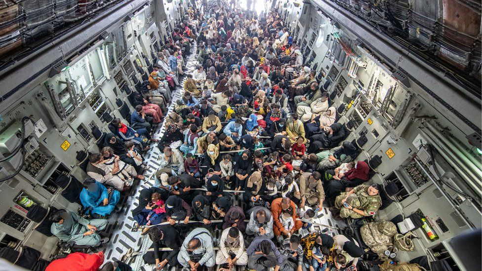 The MoD has released a picture of people on an evacuation flight out of Kabul