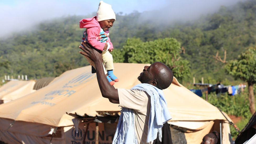 Kelvin Charamba and his daughter Faith in front of a tent in Ngangu Chimanimani, Zimbabwe - Friday 13 March 2020