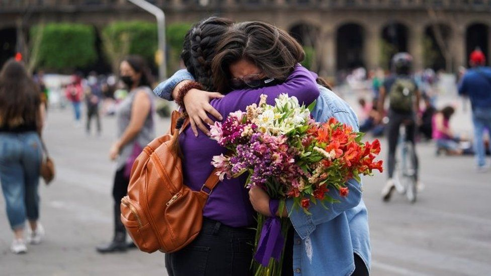 Women embrace outside the National Palace ahead of a Women's Day protest in Mexico City, Mexico March 7, 2021.