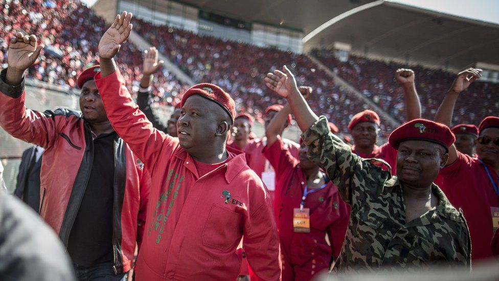 South Africa's Economic Freedom Fighters leader Julius Malema waves at supporters during a provincial electoral campaign rally in Pretoria on 4 May 4 2014