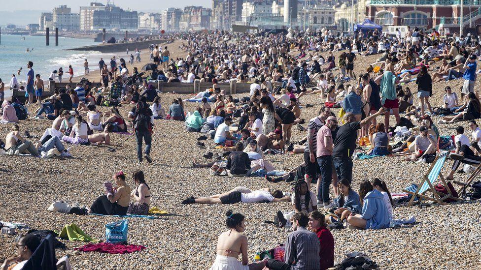 People gathered on Brighton beach on Tuesday
