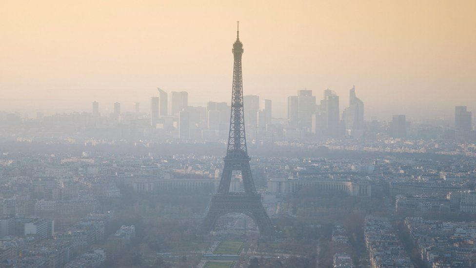 The Eiffel Tower in the smog: Paris