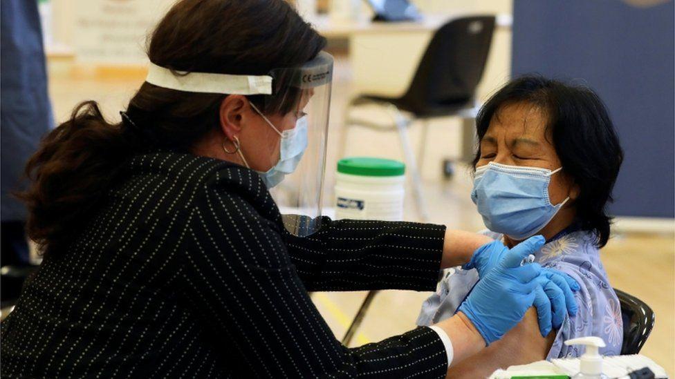 Anita Quidangen receiving vaccine