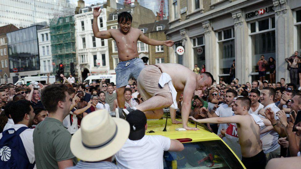 England fans celebrating damaged ambulance
