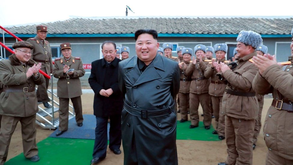 "A state media image said to show Kim Jong-un inspecting the testing of a ""super-large multiple-rocket launcher"""