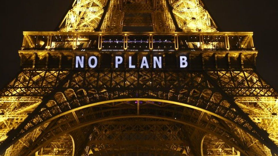 """A slogan """"No plan B"""" is projected on the Eiffel Tower as part of the COP21"""