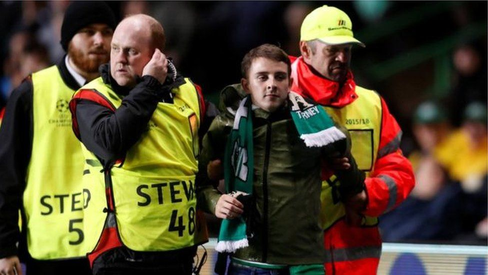 John Hatton was led away by stewards after the incident in the 40th minute of the game