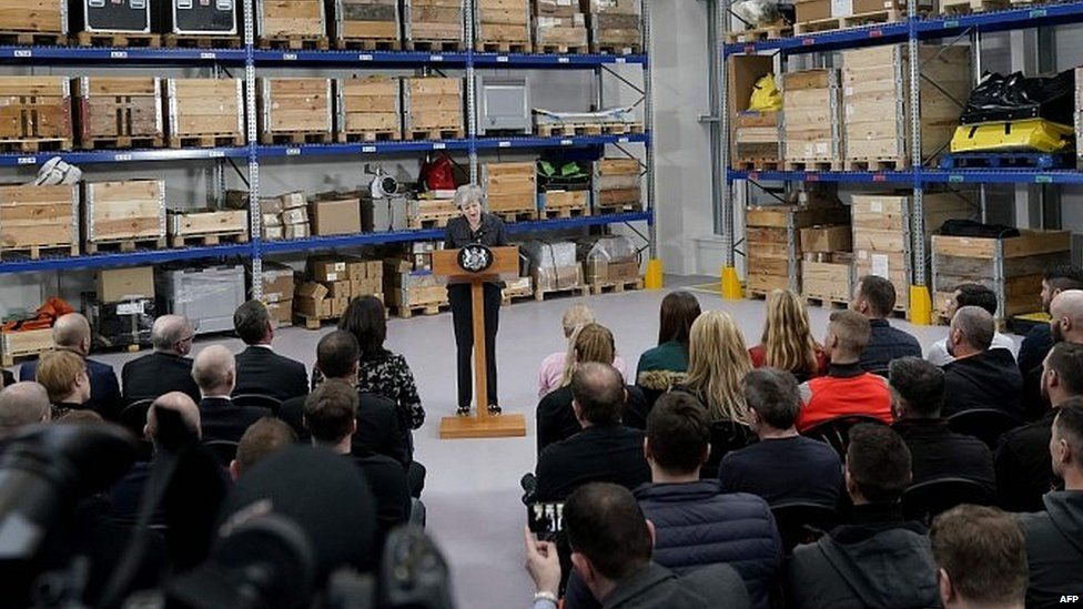 Theresa May speaking at Grimsby facility of the green energy firm Orsted
