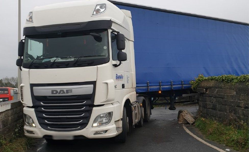 Lorry wedged on bridge