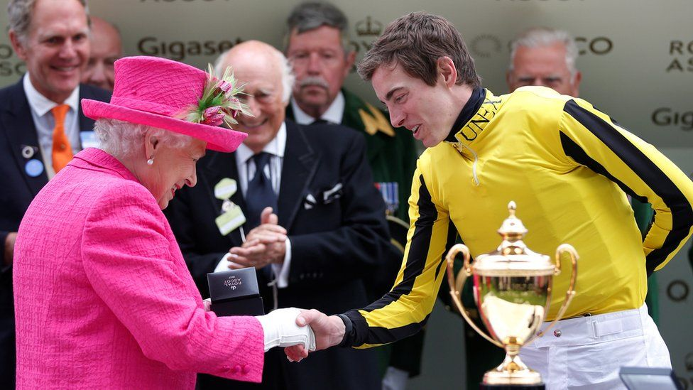 The Queen shaking hands with jockey James doyle