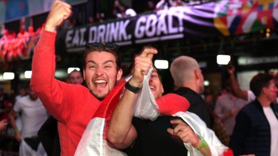 Fans celebrate Luke Shaw's goal in Croydon
