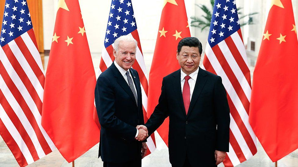 Chinese President Xi Jinping (R) shake hands with U.S Vice President Joe Biden (L) inside the Great Hall of the People on December 4, 2013 in Beijing, China