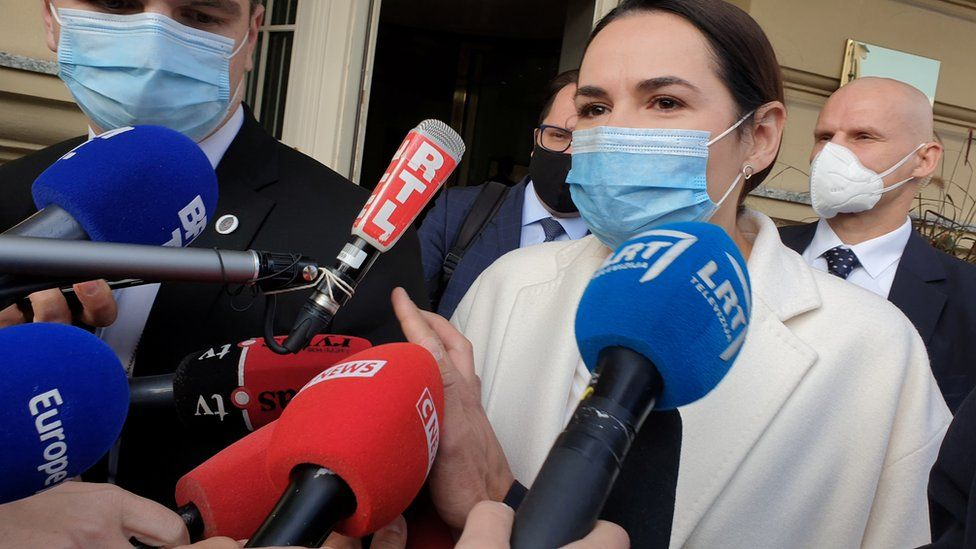 Belarus opposition leader Svetlana Tikhanovskaya emerges from her meeting with French President Emmanuel Macron