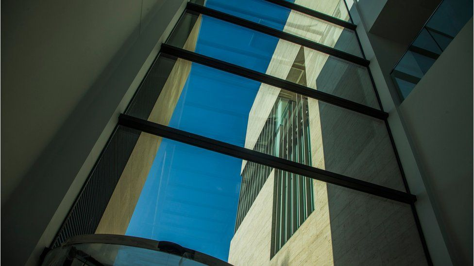 Glass and steel - looking out to part of the building from inside another part of Pontio