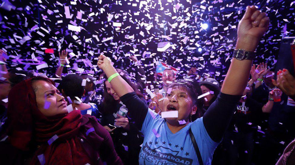 Supporters celebrate the victory of Alexandria Ocasio-Cortez at La Boom night club in Queens on November 6, 2018