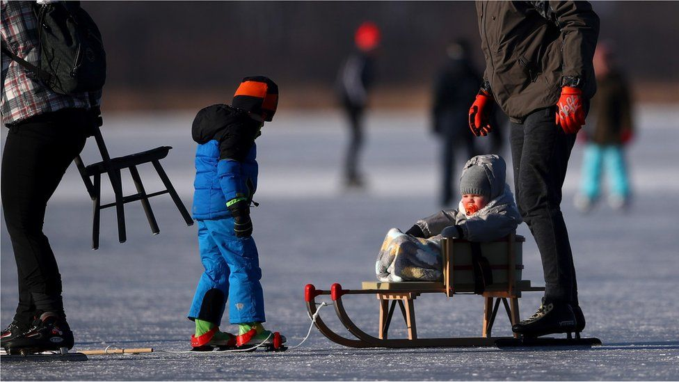 People skate on the Nannewiid, a lake frozen over as temperatures stay below zero and locals enjoy activities like speed skating, ice hockey, using sleds and walking dogs on February 12, 2021 in Oudehaske, Netherlands.