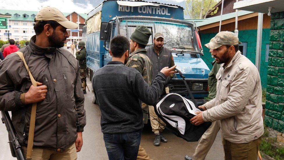 An Indian policeman checks the bag of a student near the main gate of National Institute of Technology (NIT) in Srinagar, summer capital of Indian administered Kashmir, 06 April 2016