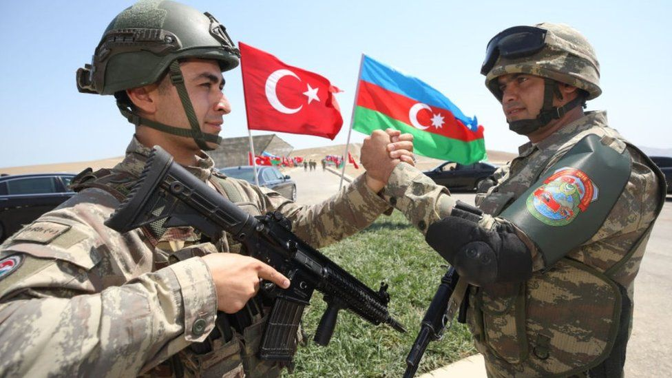 Troops from Azerbaijan and Turkey shaking hands, Aug 2020