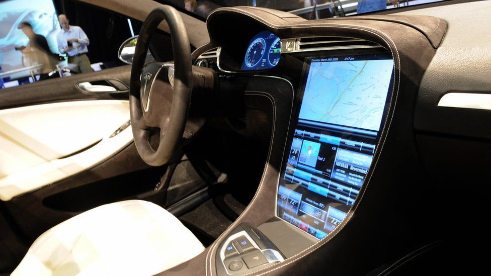 Interior of Tesla car showing large computer screen