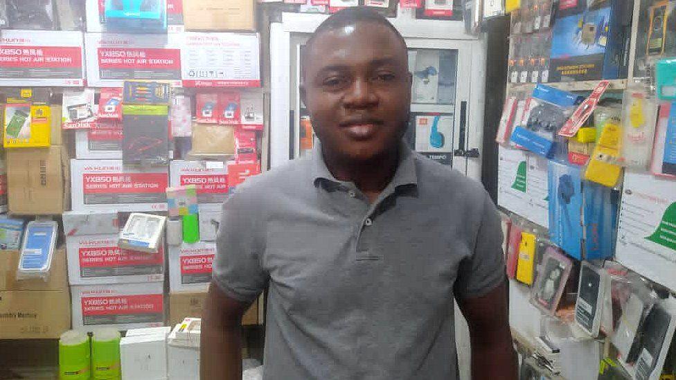 Onyeka Orie inside his phones' accessories shop