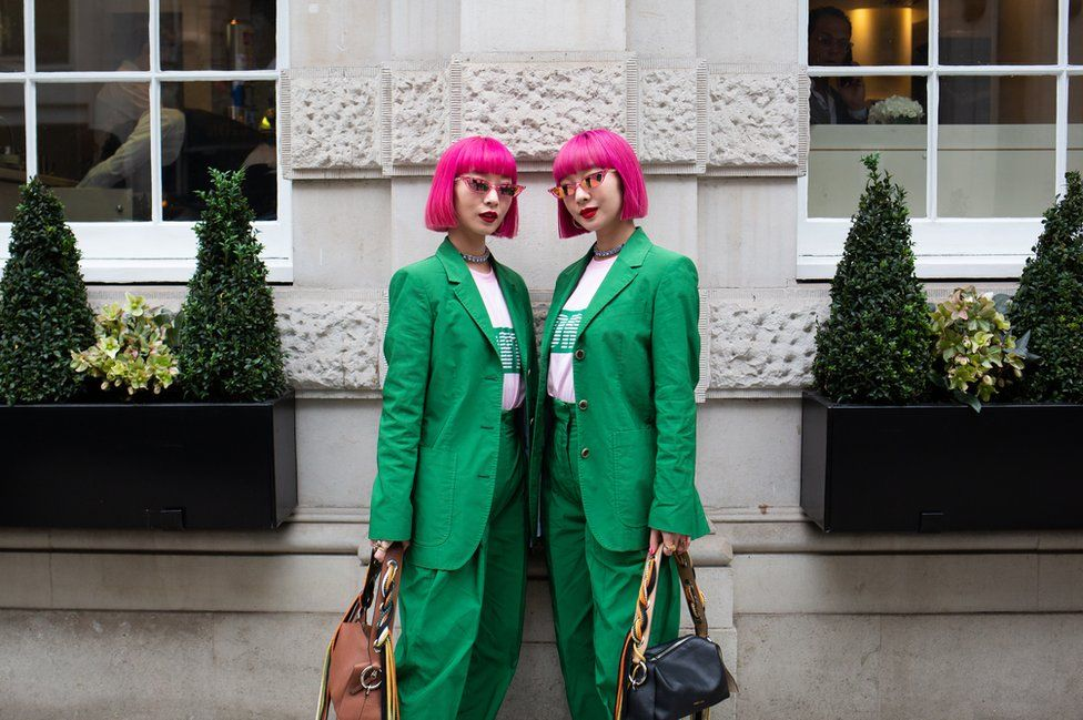 Twins Ami and Aya outside Christie's, London
