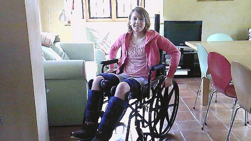 Author Emily Koch in a wheelchair after her accident