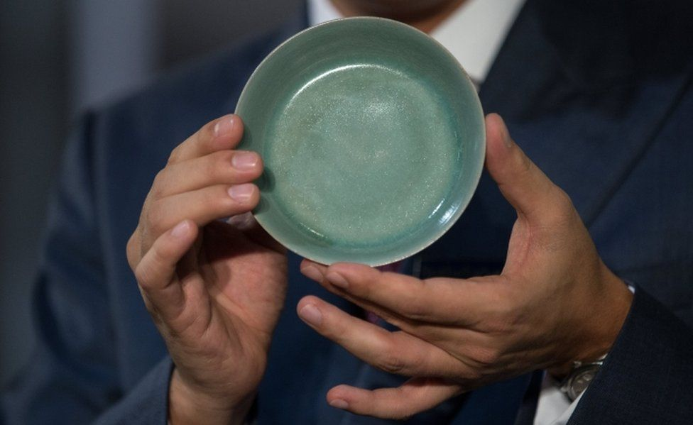 Nicolas Chow, Deputy Chairman of Sotheby's Asia International, holds a Ru Guanyao Brush Washer from the Northern Song Dynasty in Hong Kong on 3 October 2017.