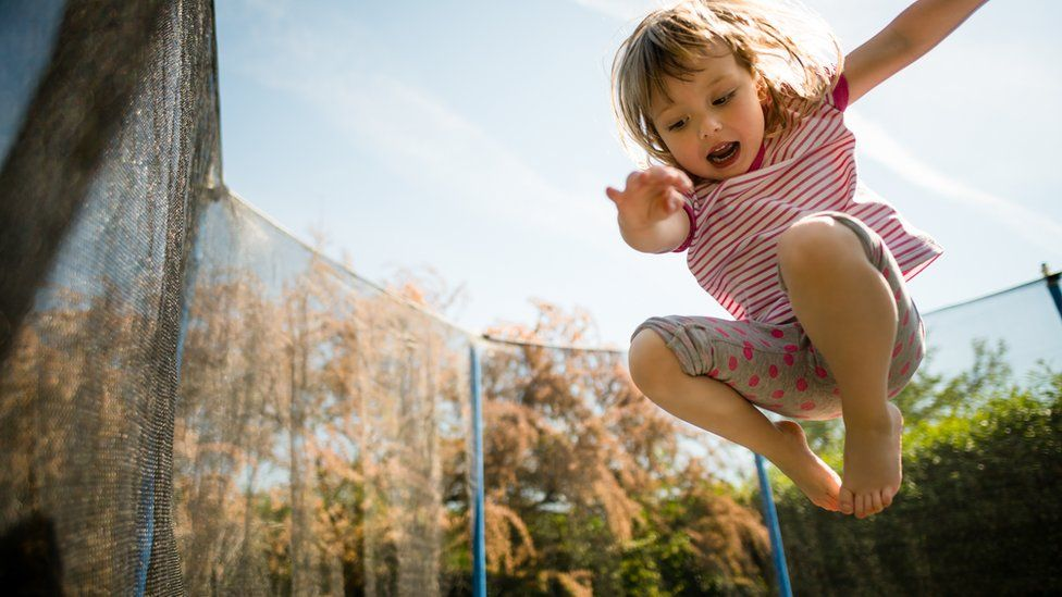 A girl on a trampoline