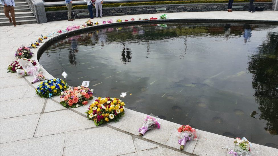 Floral tributes placed in the Omagh bomb memorial garden