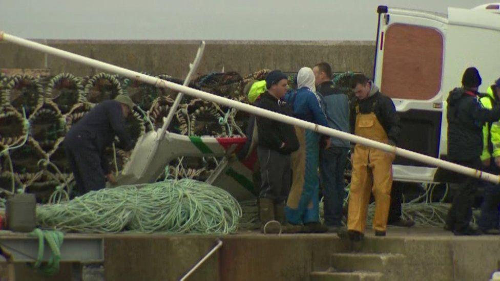 wreckage being taken ashore