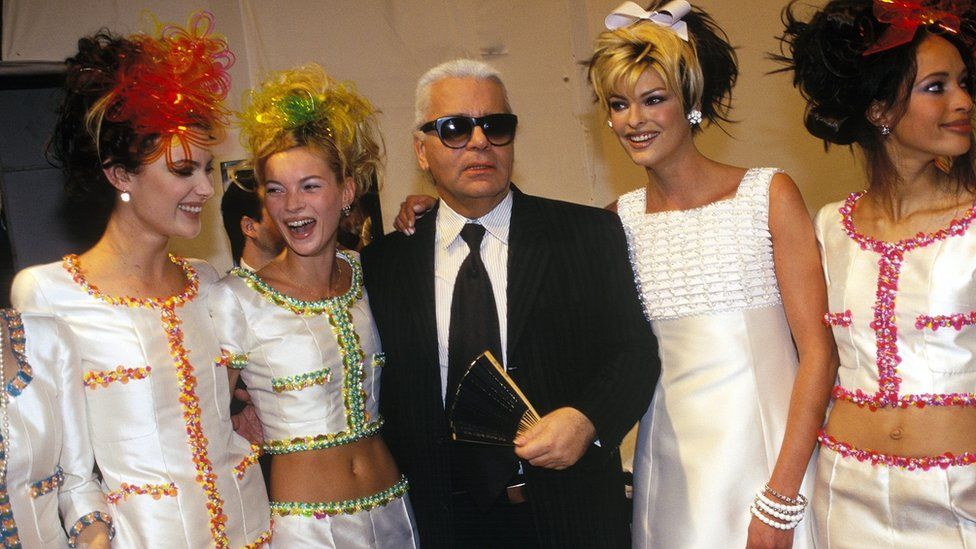 Karl Lagerfeld with models