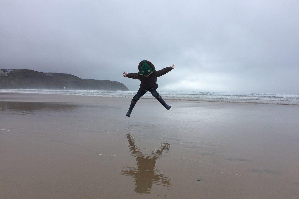 Boy jumping on a beach