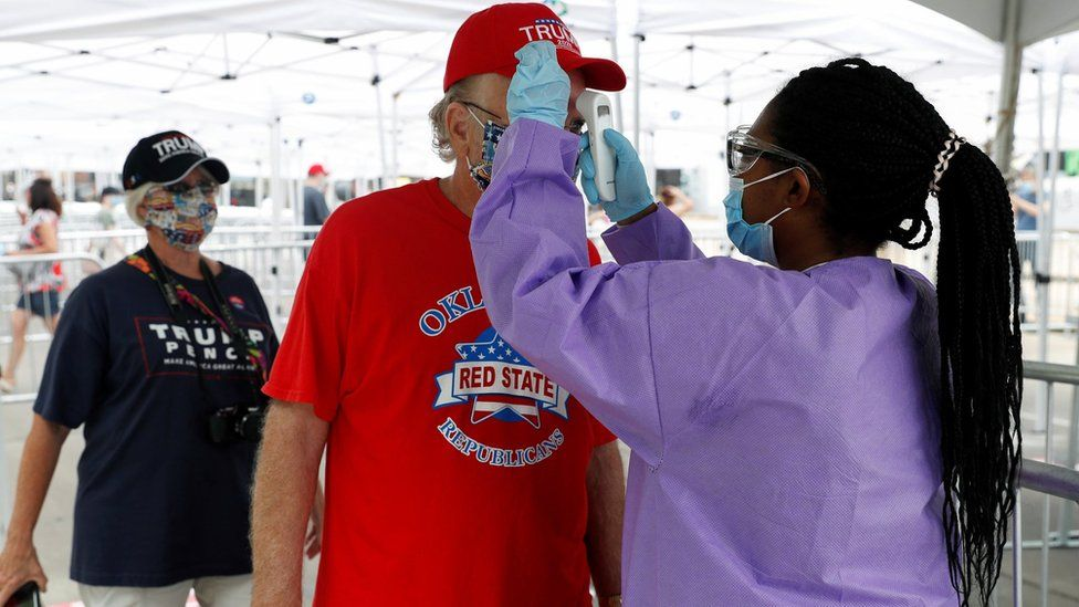 A man has his temperature checked at the entrance to a rally for President Donald Trump in Tulsa (20 June 2020)