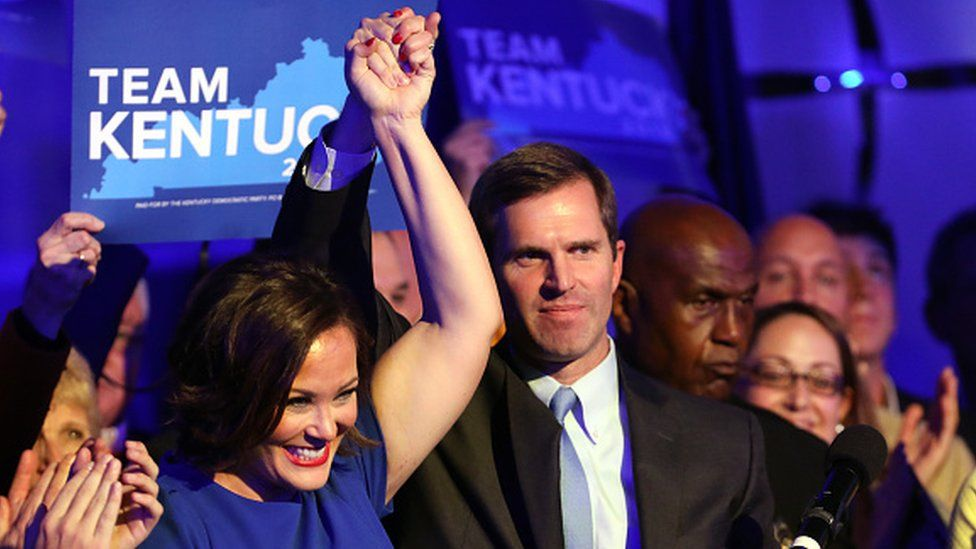 Democrat Andy Beshear celebrates with supporters after voting results showed he won the Kentucky governor's race