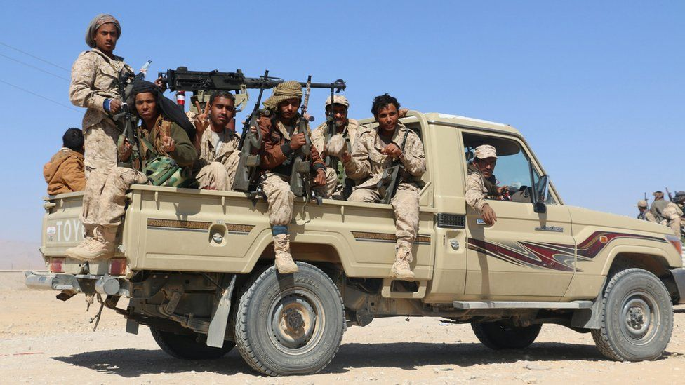 Armed tribesmen loyal to Yemen's Saudi-backed government