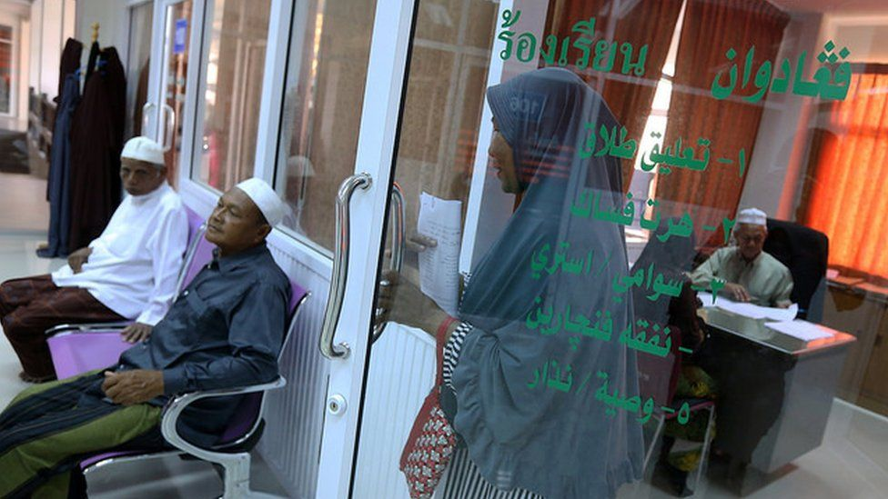 A Muslim woman walks out of the complaint room at Pattani's Islamic Council.