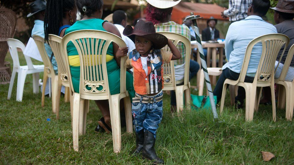 Alvin Kivumbi, aged three, wears a cowboy outfit in Kampala